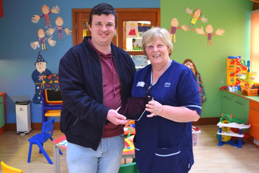 MAIN Generous locals pull together to replace missing iPad - Arthur Hayburn with scn Catherine Borland